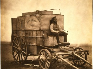 The artist´s van [Marcus Sparling, full-length portrait, seated on Roger Fenton´s photographic van] 1855