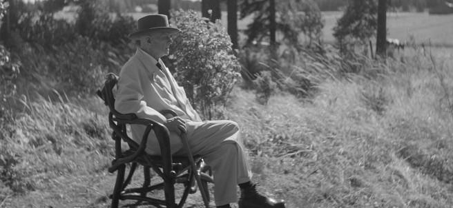 Santeri Levas: Jean Sibelius in his tree root chair in the border area of the Ainola grounds, 1940-1945
